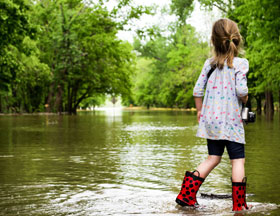 Child on flooded roadway