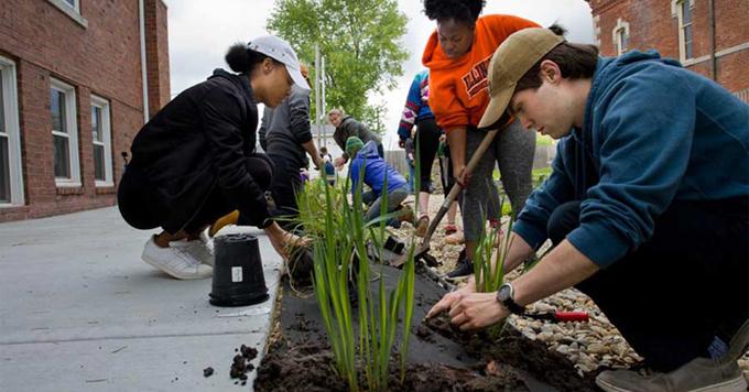 Students planting rain garden