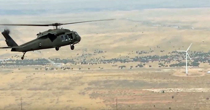 Army helicopter and wind turbine