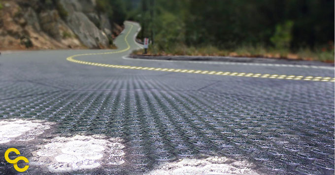 A close up shot of solar roadway panels paving a winding mountain road