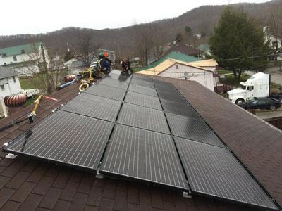 Trainees installing solar panels