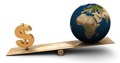 Earth globe balancing on seesaw
