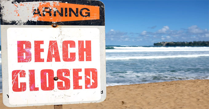 Beach closed signage