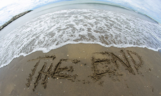 "Beach writing in the sand ""the end"""