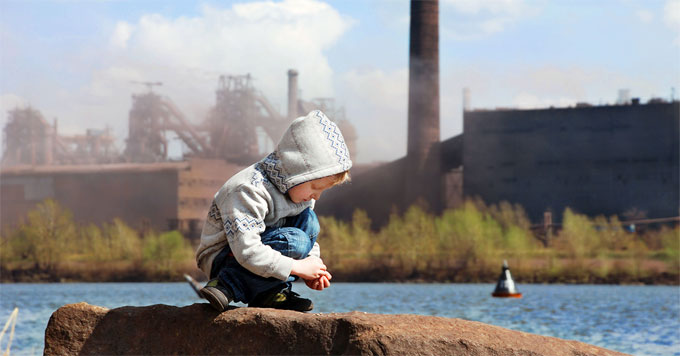 Child and smokestacks