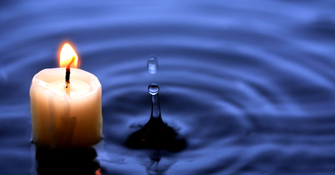 Candle and water droplet