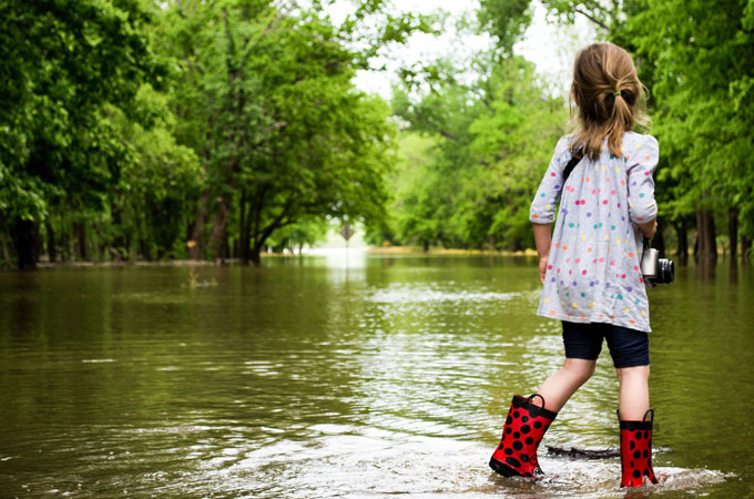 Child walking in floodwater