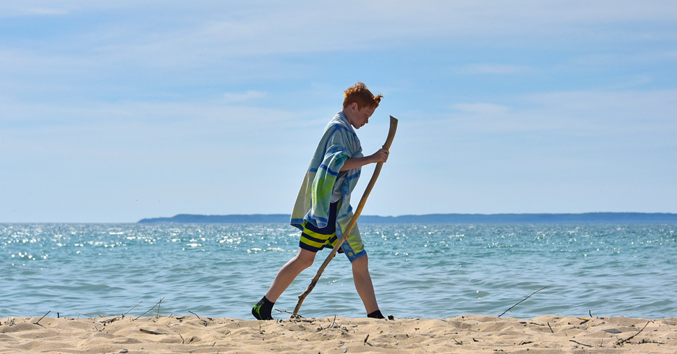 Boy on Lake Michigan beach