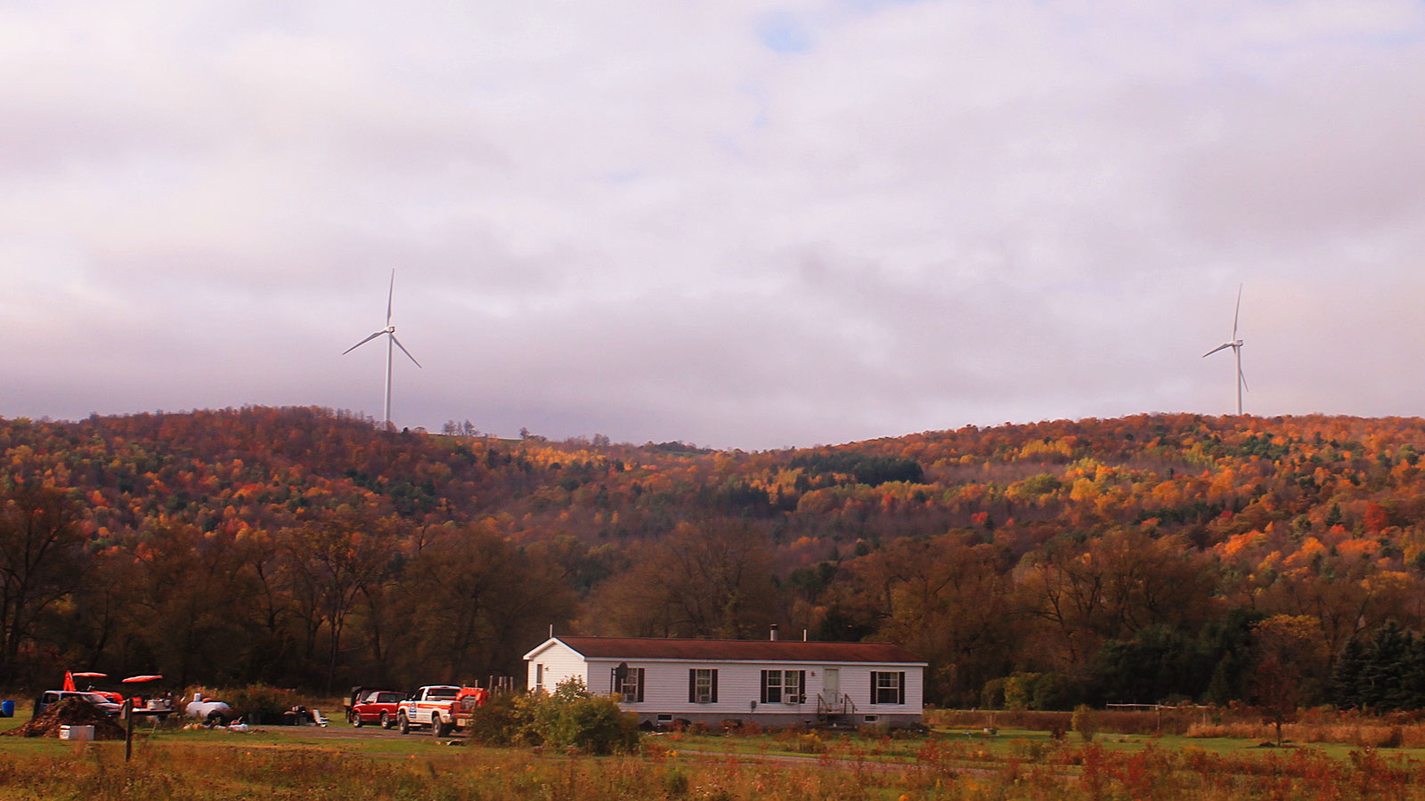 Countryside home and wind turbines